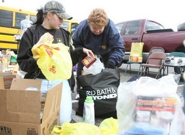 "Volunteers with donated goods at the ""Stuff the Bus"" event to aid Hurricane Sandy victims"