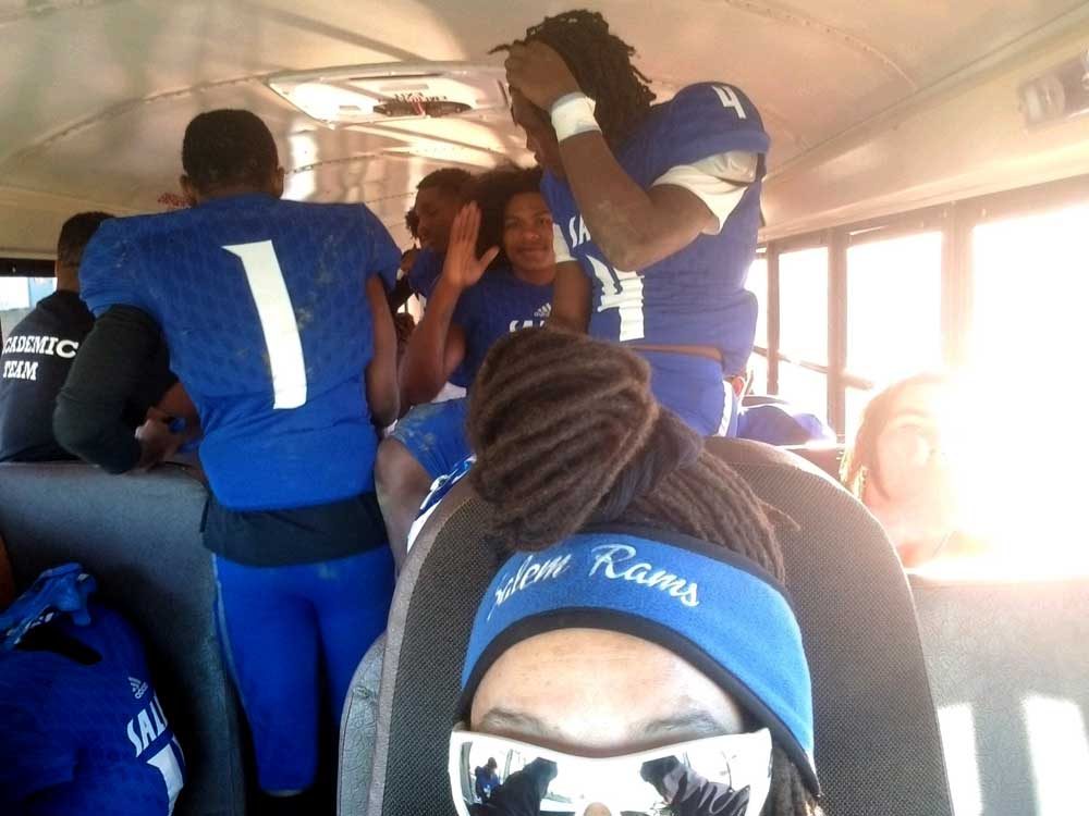 Bus driver transporting football players.