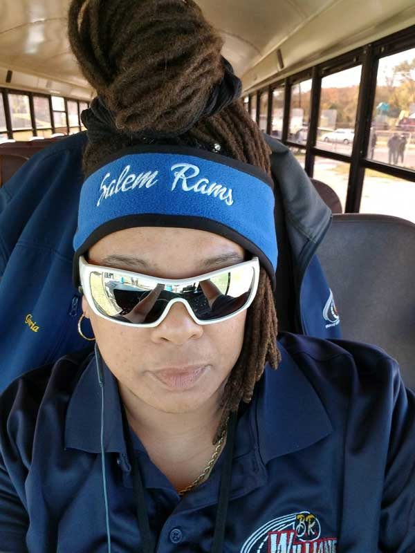 Bus driver wearing a Salem Rams headband.