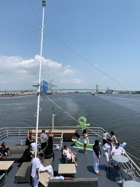 People on the deck of the SMS Spirit of Philadelphia on the Delaware River