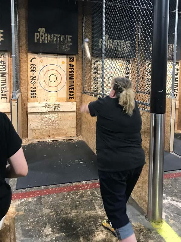 Woman throws her axe at the Axe-travaganza