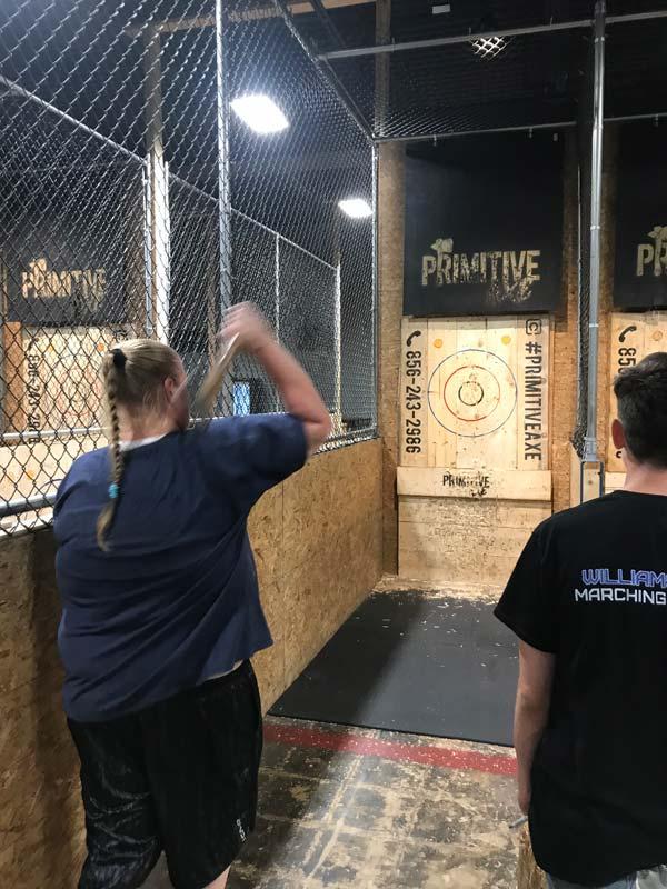 Woman throwing axe during our Axe Throwing Axe-travaganza