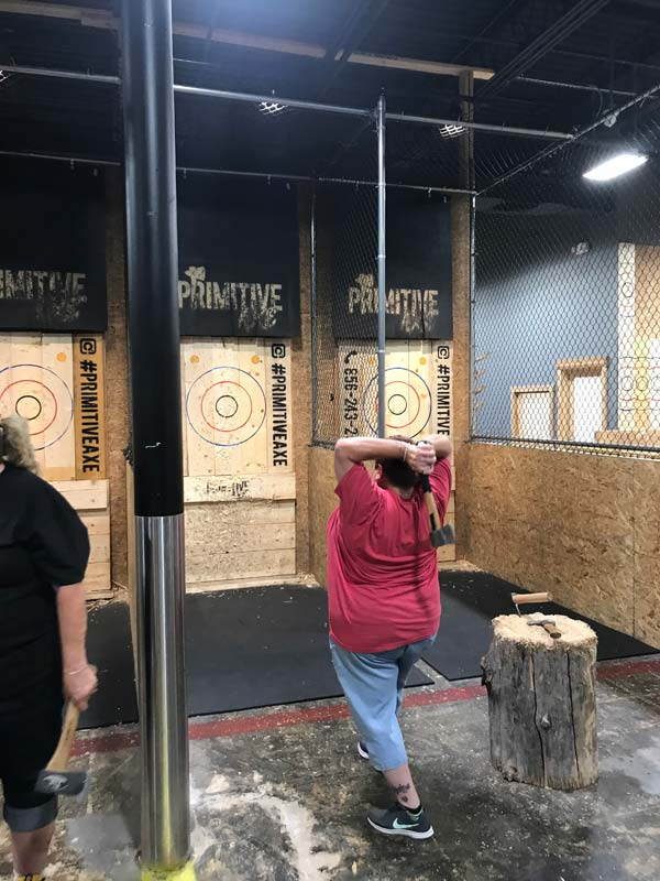 A woman getting ready to throw an axe during Axe-travaganza event