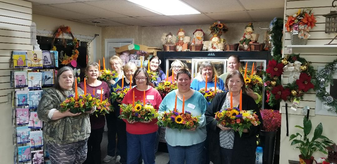 Group of ladies with floral arrangements, part of a Fun Night Out